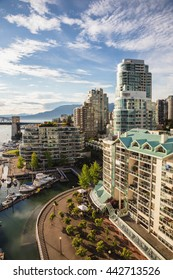 View of Downtown Vancouver and Burrard Bridge at False Creek, British Columbia (BC), Canada, during sunny evening.