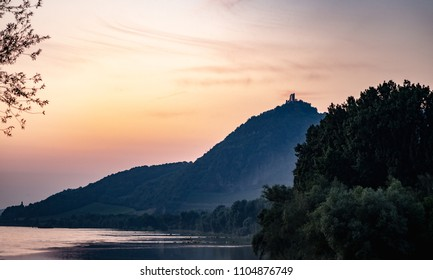 View of Drachenfels from across the Rhine River at dusk