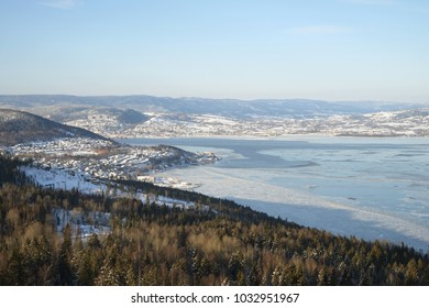 View of Drammen fjord in winter time from forest on top of a local mountain.
