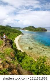 View of Drawaqa Island coastline and Nanuya Balavu Island, Yasawa Islands, Fiji. This archipelago consists of about 20 volcanic islands