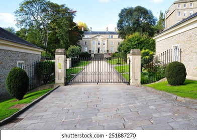 View of a Driveway and Gated Entrance of Old English Residential Buildings