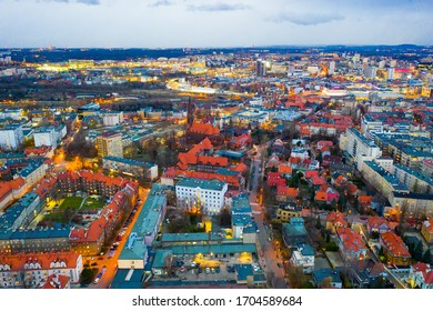 View from drone of Katowice cityscape at twilight in spring, Silesia Province, Poland