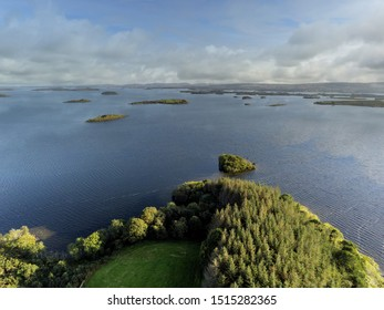 View from a drone on Lake Corrib, county Galway, Ireland, Cloudy sky, blue water surface, island and forest.