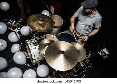 up view. The drummer in action. A photo close up process play on a musical instrument. dark dramatic light.