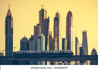 View of Dubai with subway and skycrapers at sunset. UAE