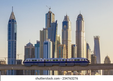 View of Dubai with subway and skyscrapers.