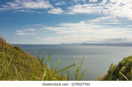 View of Dublin Bay from the cliffs on Howth Head near Dublin, Ireland. Bray Head can be seen across the bay in the distance.