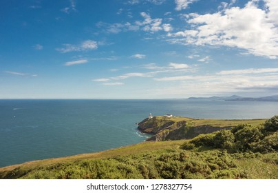 View of Dublin Bay from Howth Head peninsula near Dublin, Ireland. The Bailey Lighthouse is in the midground and Bray Head in the background.