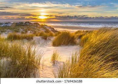 View from dune top over sunset in North Sea from the island of Ameland, Friesland, Netherlands