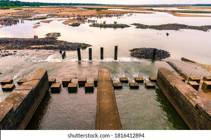 """View of Durgapur Barrage and  Indian Hindu people do Faithfuls offer """"Tarpan"""" to the divine for the liberation of the soul of their deceased elders ."""