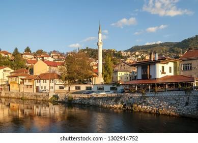 View during sunset of the Historic centre of Sarajevo, Bosnia and Herzegovina. Miljacka River and Vekil-Harrach (Vekil-Harač) Mosque in Alifakovac, one of the oldest neighborhoods in Sarajevo.