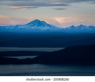 View at dusk of Mt. Baker, Cascade Range, Bellingham Bay, Lummi Island, and Rosario Strait from Mt. Constitution, Moran State Park, Orcas Island, San Juan Islands, WA