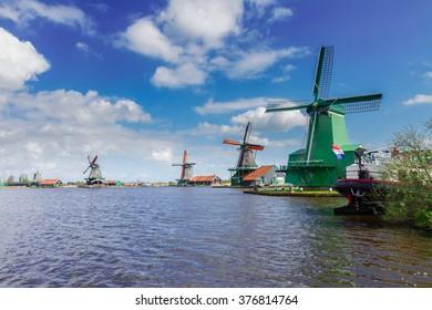view of dutch windmills in Zaanse Schans at sunny day, Holland