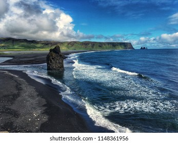 View from Dyrholaey small peninsula on the south coast of Iceland on black sand Reynisfjara Beach