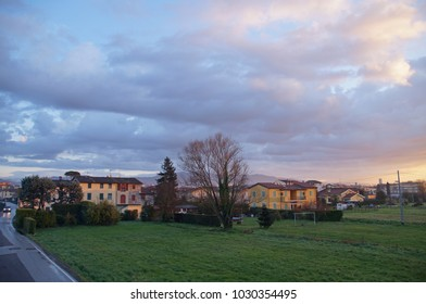 View in the early morning towards small houses in the beginning of Lucca, Tuscany