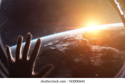 View of Earth planet from spaceship or space station. Elements of this image furnished by NASA