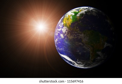 view of earth and sun from space orbit (image of earth taken from http://visibleearth.nasa.gov)