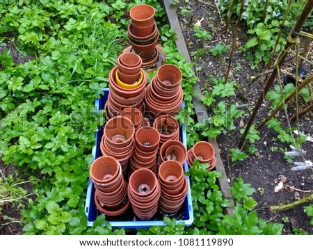 View Of Earthenware Old Garden Pots Inbox Placed In Raised Beds In Organic  English Country Garden