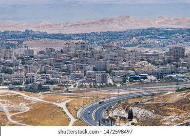 view of east jerusalem from mt scopus with the dead sea and hazy mountains of Jordan in the background