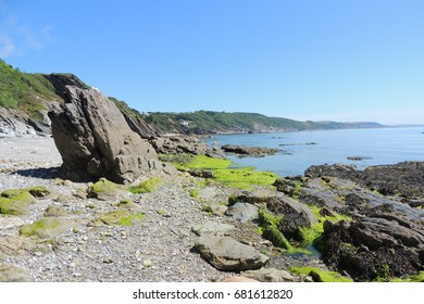 A view from east Looe beach, looking east towards the Rame head peninsular and Plymouth in Devon