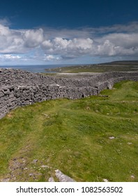 The view east, northeast from an outer enclosure of Dun Aonghasa (Dun Aengus) looking along the outer concentric wall.  Inishmore, the Aran Islands, County Galway, Ireland.