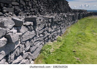 The view east, northeast from an outer enclosure of looking along the concentric wall surrounding the inner enclosure of Dun Aonghasa (Dun Aengus).  Inishmore, Aran Islands, County Galway, Ireland