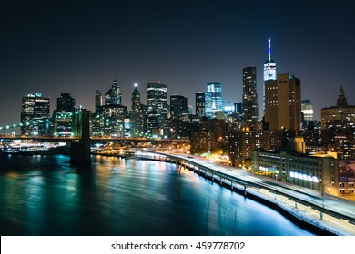 View of the East River and Lower Manhattan skyline at night, from the Manhattan Bridge Walkway, New York.