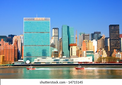 View of the east river and Manhattan skyline featuring the United Nations building.
