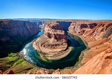 View from the edge of the cliff at Horseshue Bend, a meander of Colorado river in Grand Canyon National Park, Arizona, United States.