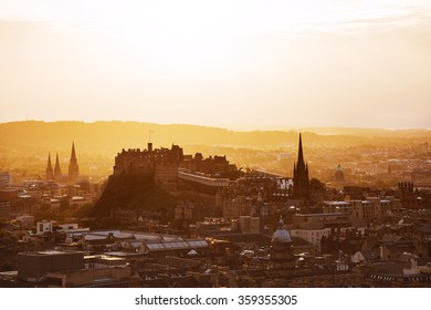 View of Edinburgh castle from Arthur's Seat peak at sunset.