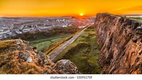 View of Edinburgh and Edinburgh castle from Arthur's Seat peak at sunset