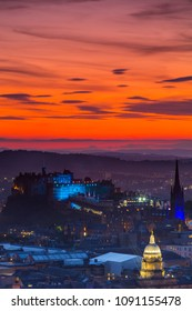 View of The  Edinburgh Castle with beautiful orange sunset sky.