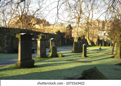 view to Edinburgh Castle from Blackfriars graveyard on a bright winters day