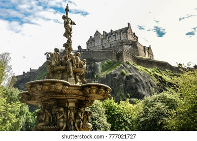 A view of Edinburgh Castle and fountain from the Princes Street gardens public park, Edinburgh, Scotland, United Kingdom