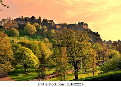View of Edinburgh Castle and Princes Street Gardens at sunset