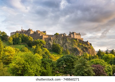 View of the Edinburgh Castle at sunset, from Princes Street Gardens