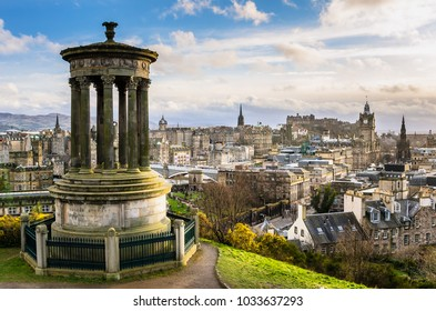View of Edinburgh City Centre From Calton Hill with Dugald Stewart Monument in Foreground on a Winter Day.