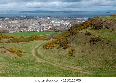 View of Edinburgh city towards coastal area of the North Sea from Arthur's Seat, the highest point in Edinburgh located at Holyrood Park, Scotland, UK
