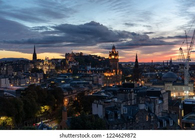 View of Edinburgh in sunset light from the side with hanging tower.