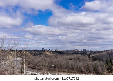 View to Edmonton North Saskatchewan river valley and downtown in spring season with bird flying