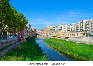 View of Eiffel Bridge (Puente Eiffel, or Pont de les Peixateries Velles) over River Onyar, Cathedral and buildings of city of Girona, Spain