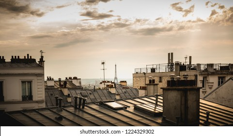 View of the Eiffel Tower above the rooftops of Paris in Montmartre