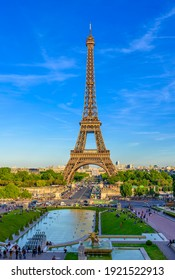 View of Eiffel Tower from Jardins du Trocadero in Paris, France. Eiffel Tower is one of the most iconic landmarks of Paris. Sunset cityscape of Paris