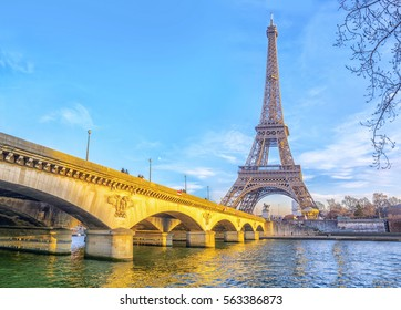 View of Eiffel Tower and Jena bridge from the Seine river in Paris at evening, France.