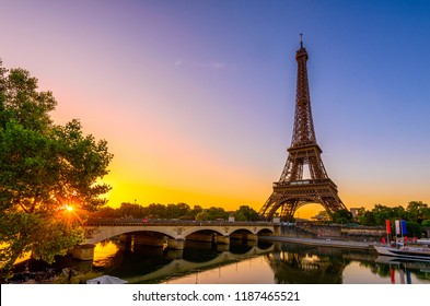 View of Eiffel Tower and river Seine at sunrise in Paris, France. Eiffel Tower is one of the most iconic landmarks of Paris. Sunrise cityscape of Paris. Architecture and landmarks of Paris.