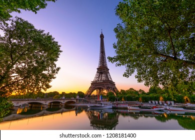 View of Eiffel Tower and river Seine at sunrise in Paris, France. Eiffel Tower is one of the most iconic landmarks of Paris. Sunrise cityscape of Paris