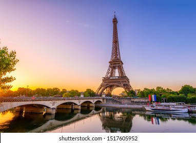 View of Eiffel Tower and river Seine at sunrise in Paris, France. Eiffel Tower is one of the most iconic landmarks of Paris. Architecture and landmarks of Paris. Postcard of Paris