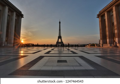 View of the Eiffel tower at sunrise from the Trocadero gardens, Paris.