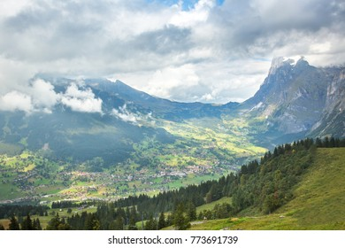 A view from the Eiger trail in the Alps mountains above Lauterbrunnen, Switzerland.  The village of Grindelwald is in the valley below.