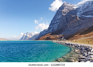 View of Eigernordwand (Eiger Northface) and Wetterhorn massif from Fallboden station and Fallbodensee (Fallboden lake) - Fallboden, Jungfrau Region, Switzerland